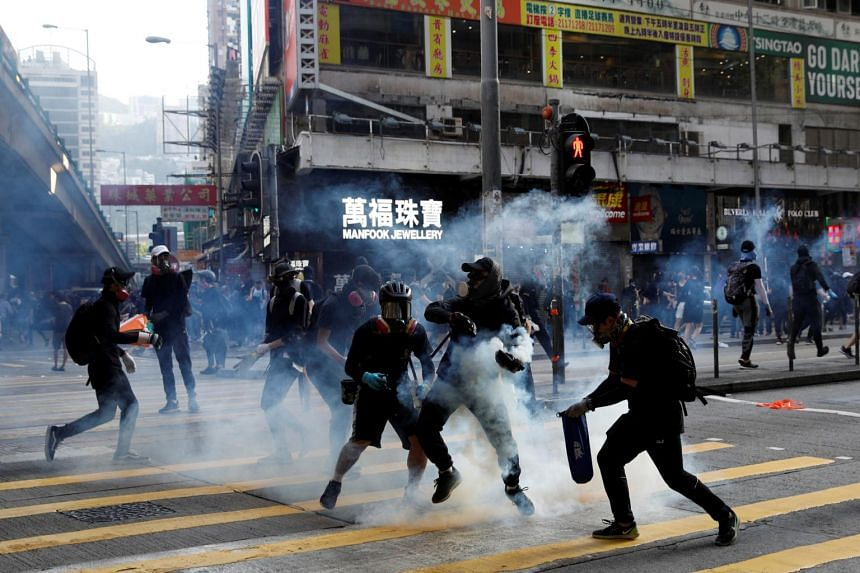 Protesters react as police fire tear gas during a protest in Hong Kong on Nov 2, 2019.