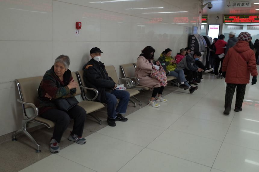 People sit in the Beijing Chaoyang Hospital in Beijing, China. Earlier this month three people from Inner Mongolia were hospitalised for plague in two separate cases that were linked to eating wild animals.