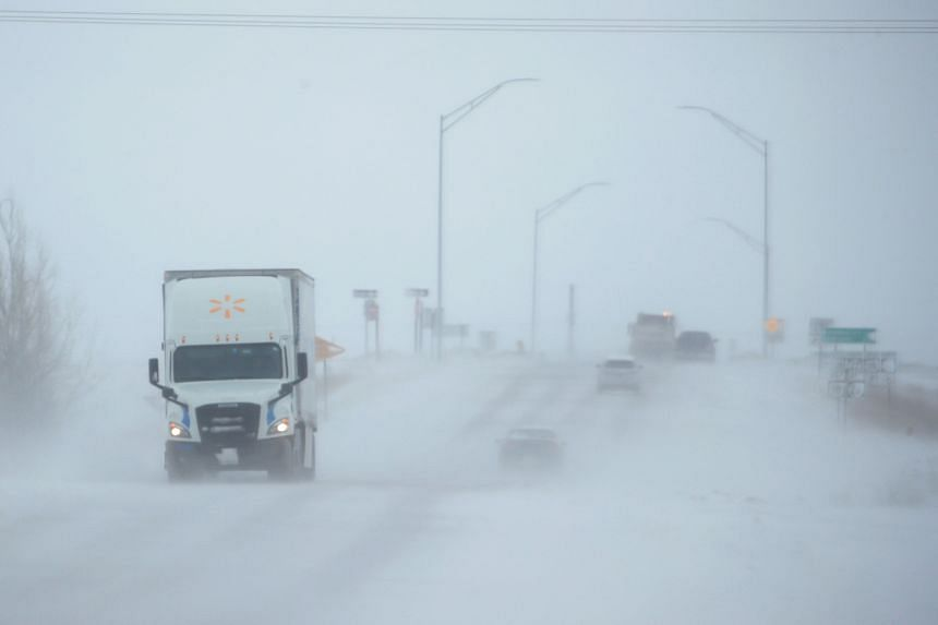 Snow blows across a road near Rudd, Iowa, in the US Midwest on Nov 27, 2019.