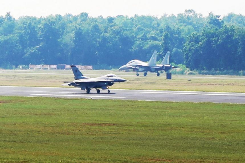 An RSAF F-16C (foreground) and an India Air Force's SU-30MKI fighter aircraft on the Kalaikunda Air Force Station runway before take-off as part of the Joint Military Exercise.