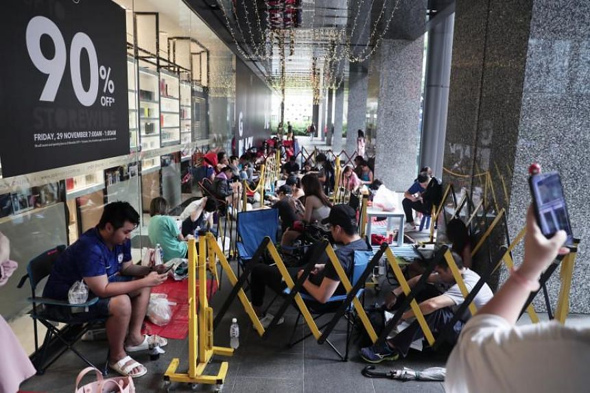 About 50 people were already in line outside Robinsons The Heeren at around 4pm on Nov 28 - 15 hours before the doors open.