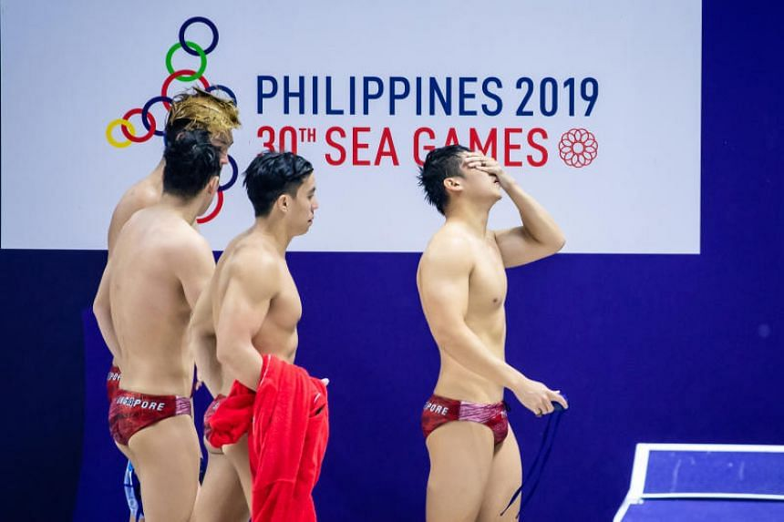 Singapore's men's water polo team reacting after their loss to Indonesia at the New Clark City Aquatics Centre on Nov 28, 2019.