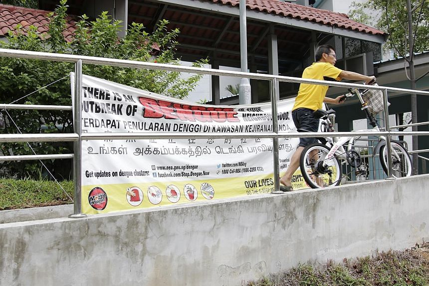 A dengue outbreak awareness banner in Ang Mo Kio. The National Environment Agency's advisory comes as the number of dengue cases so far this year has risen more than five times from the same period last year.