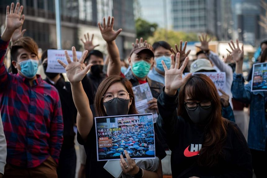 People gather in support of pro-democracy protesters during a lunch break rally in the Kwun Tong area in Hong Kong on November 27, 2019. Our Asian Insider podcast discusses the potential ramifications from the ongoing unease over Hong Kong's future.