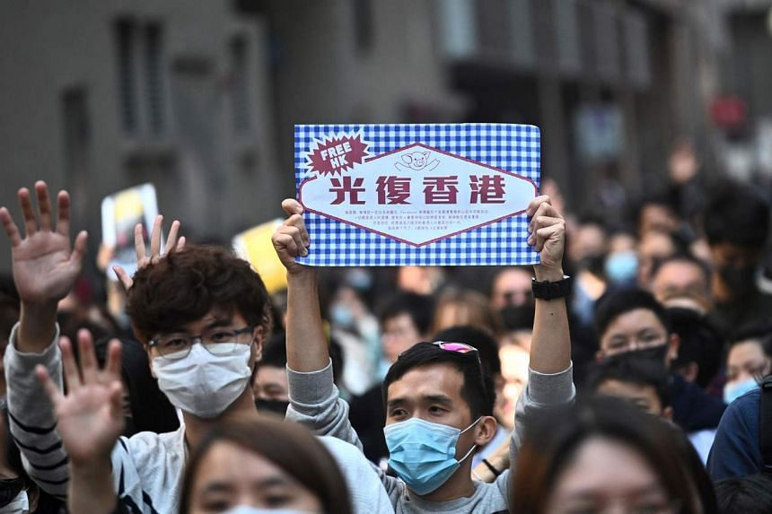 "A protester holds a placard with a design similar to the branding of ""Life Bread"" in Hong Kong's Cheung Sha Wan district on Nov 29, 2019."