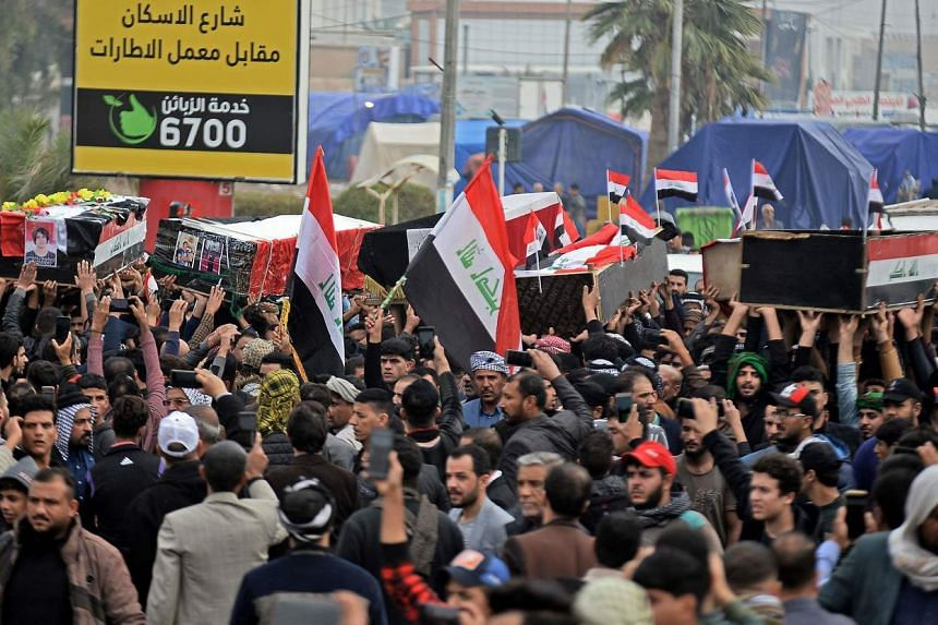 Iraqis carry the coffins of anti-government demonstrators killed during protests a day earlier in Najaf on Nov 29, 2019.