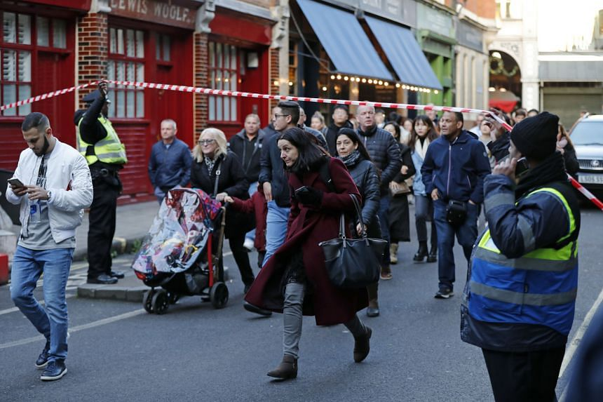 Police evacuate people from Borough Market on the south side of London Bridge in London on Nov 29, 2019.