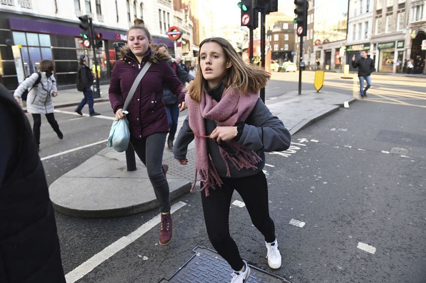 People are evacuated from London Bridge in central London following a police incident on Nov 29, 2019.