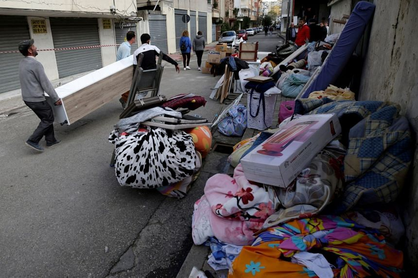 People moves their belongs after the earthquake, in Durres, Albania.