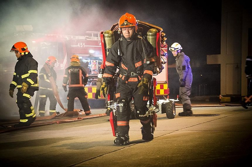 A member of the Singapore Civil Defence Force wearing an air-powered exoskeleton suit, believed to be the first of its kind in the world. It allows firefighters to carry heavy equipment of up to 40kg up multiple flights of stairs, and works in high h