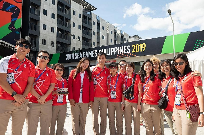 Team Singapore chef de mission Juliana Seow (fourth from left) with some athletes and officials during the welcome ceremony at the Games Village in the Philippines.