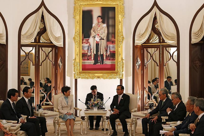 Hong Kong Chief Executive Carrie Lam meeting Thai Prime Minister Prayut Chan-o-cha at Government House in Bangkok yesterday. Among those present were Deputy Thai Prime Minister Somkid Jatusripitak (fourth from right) and Hong Kong Commerce and Econom