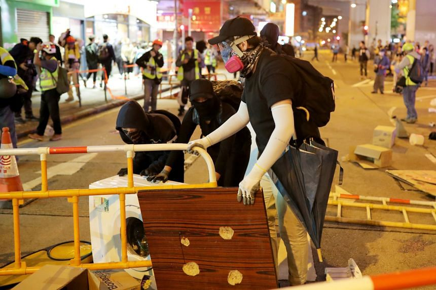 Protesters set up a barricade on a street outside Prince Edward MTR station in Hong Kong on Nov 30, 2019.