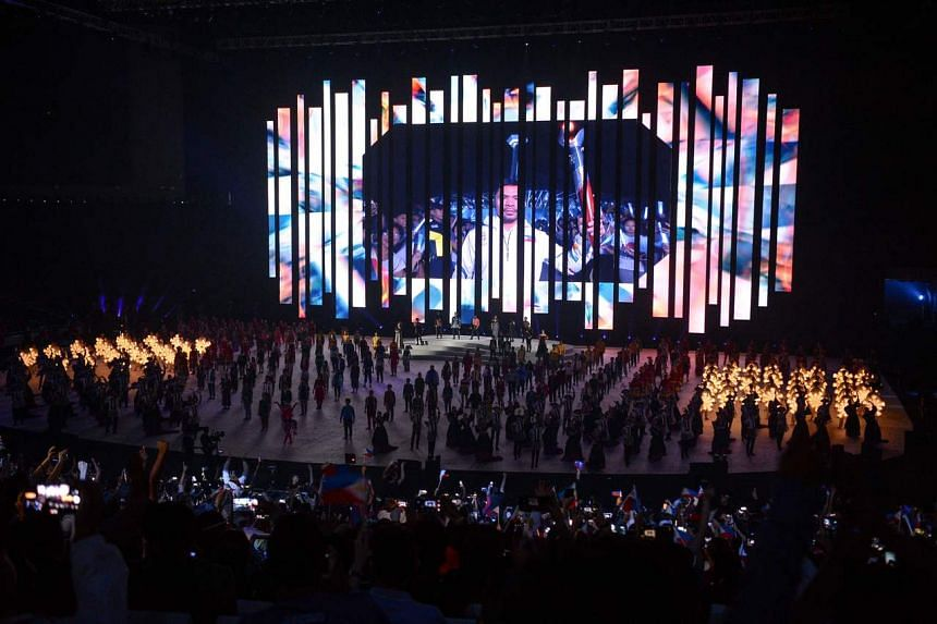 Philippine boxing champion Manny Pacquiao is seen on a pre-recorded video as he leads the lighting of the cauldron during the opening ceremony of the SEA Games at the Philippine Arena in Bocaue on Nov 30, 2019.