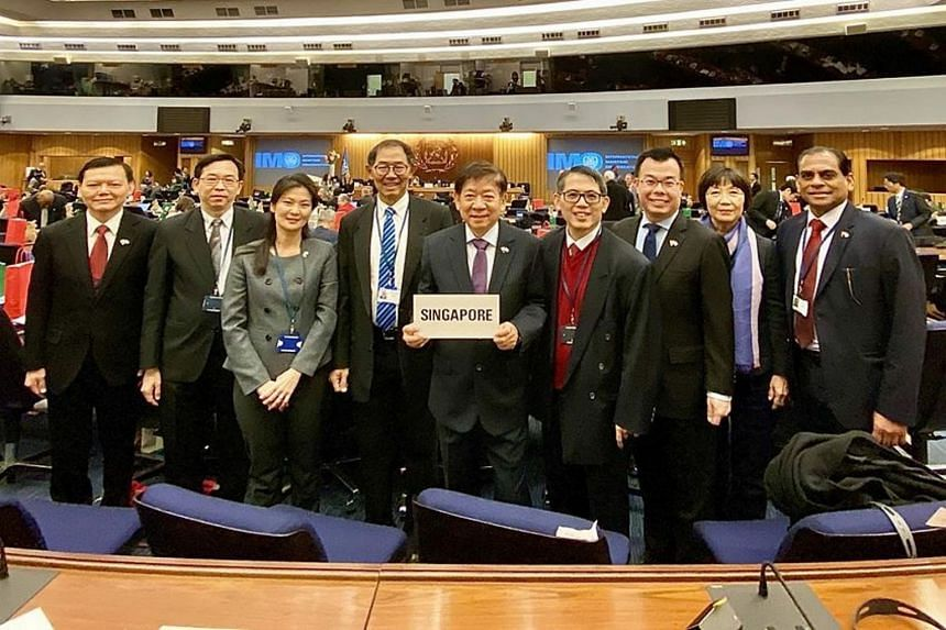 Mr Khaw Boon Wan (centre) with the Singapore delegation comprising officials from the Ministry of Transport and the Maritime and Port Authority of Singapore.