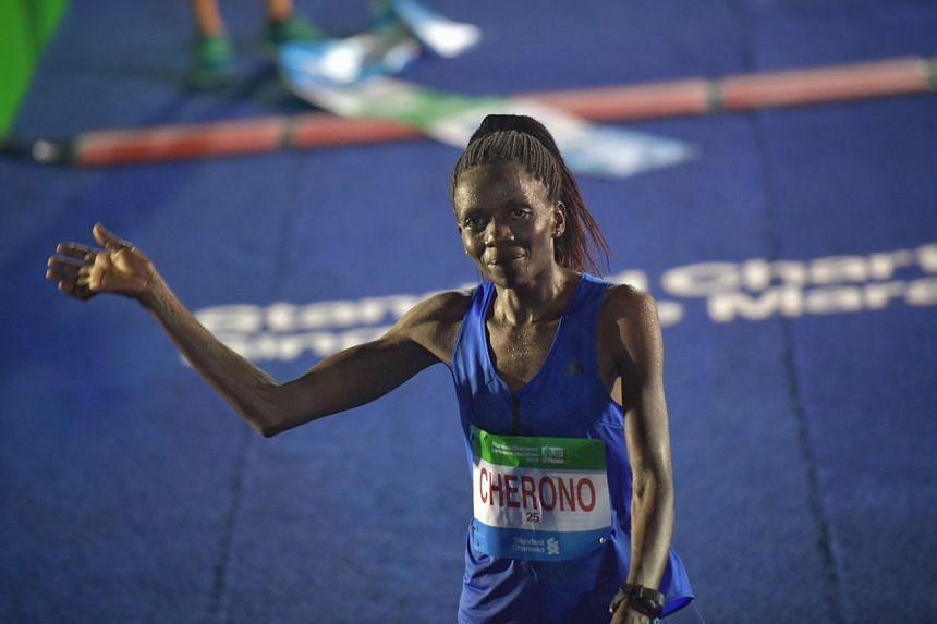 Kenyan Priscah Cherono winning the women's race at the Standard Chartered Singapore Marathon 2019.