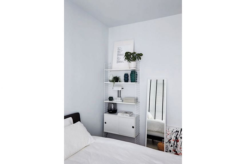 The master bedroom has a mostly white palette for a restful ambience.
