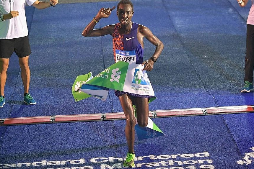 Joshua Kipkorir coming home to retain his title in a relatively poor time of 2hr 19min 13sec, nearly seven minutes slower than last year - owing to the higher temperature and humidity at night compared to the wee hours.