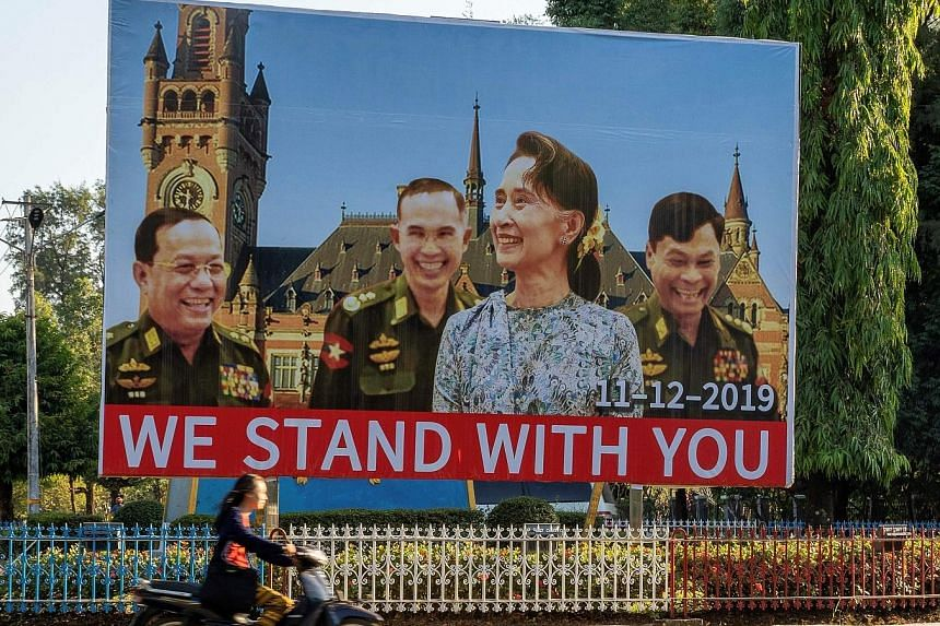 A billboard in Myanmar's Karen state shows Ms Aung San Suu Kyi and military ministers (from left) Ye Aung, Sein Win and Kyaw Swe, with the International Court of Justice building in the background. The Myanmar leader will represent her country at the