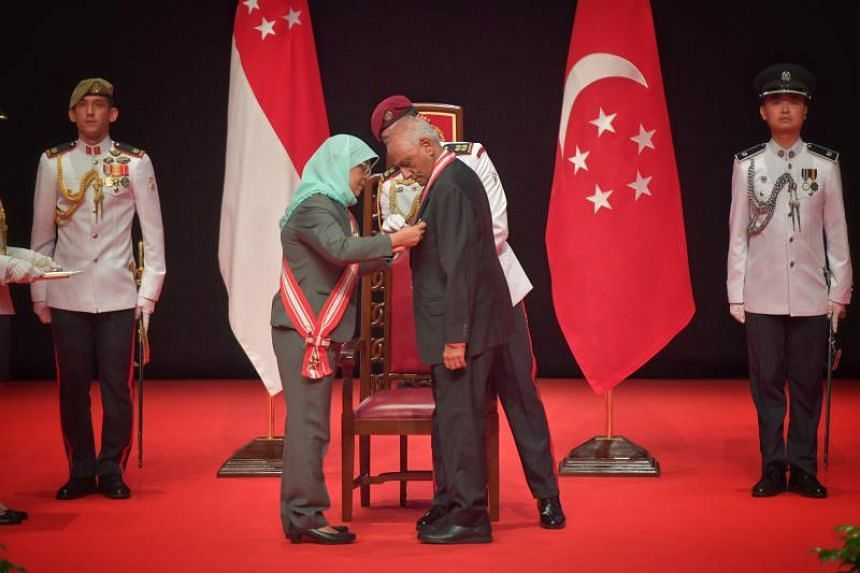 President Halimah Yacob (left) presenting The Order of Temasek (with distinction) to Mr J Y Pillay, former chairman of the Council of Presidential Advisers, at the Investiture of the 2019 National Day Awards held at ITE College Central, on Dec 1, 201