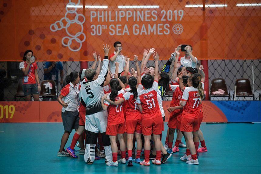 Singapore's women's floorball team celebrates beating Thailand 3-2 at the SEA Games in Manila on Dec 1, 2019.