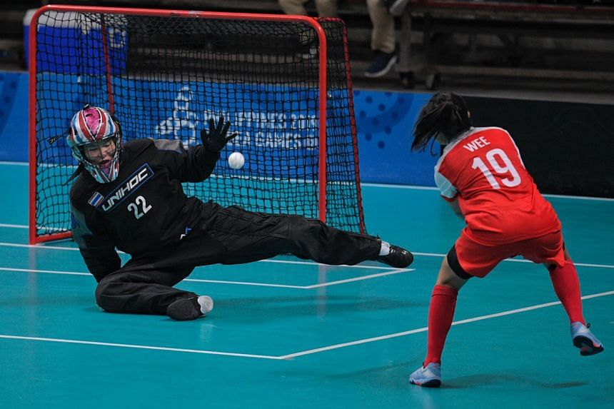 Singapore drew first blood through Natalia Wee in the seventh minute of the floorball final against Thailand at the University of Philippines College of Human Kinetics gym on Dec 1, 2019.
