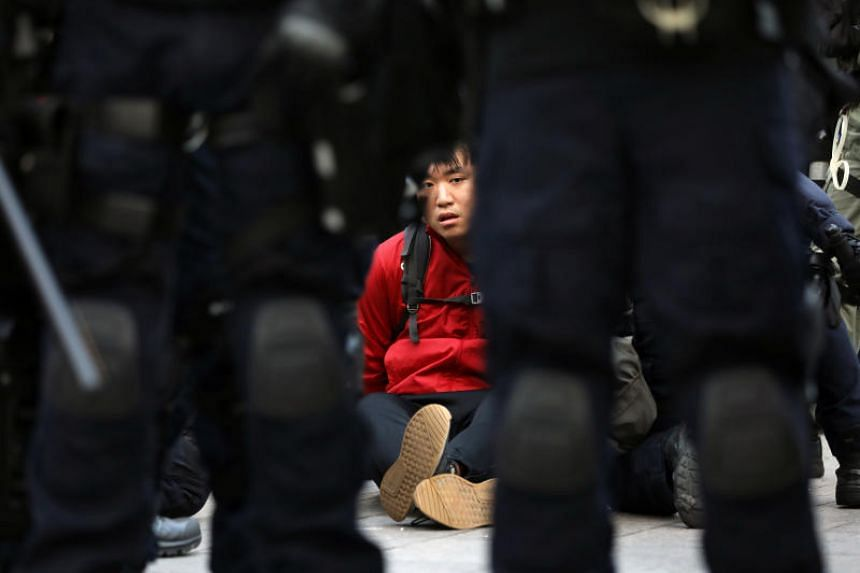 A protester is detained by police during a rally in Hong Kong on Dec 1, 2019.