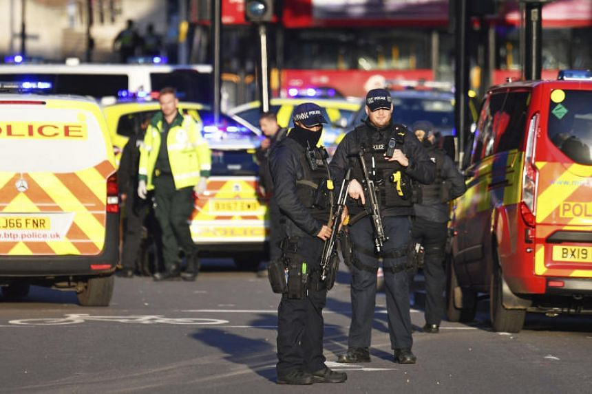 Armed police officers standing guard at London Bridge following a stabbing incident, on Nov 29, 2019.