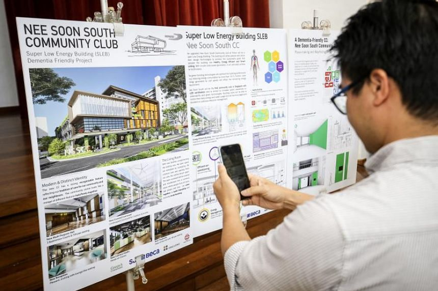 A visitor taking a picture of the plans for the new Nee Soon South Community Club, on Dec 1, 2019.