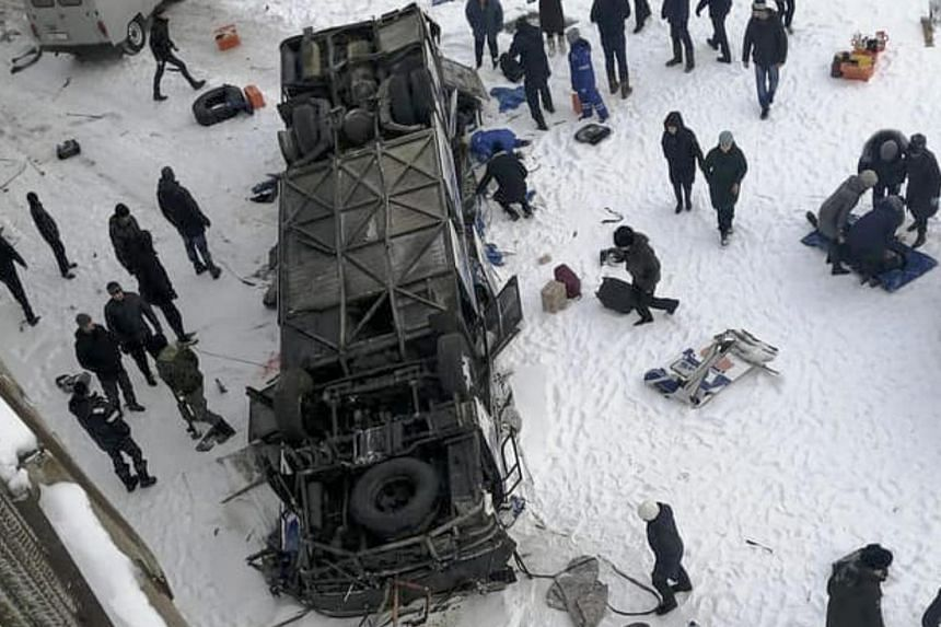 People gathering at the site a where bus plunged from a bridge over the Kuenga River, near Sretensk, Russia, on Dec 1, 2019.