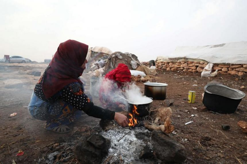 Syrians displaced from their homes arrive in Maar Shurin, on the outskirts of Maaret al-Numan in Syria's Idlib province on Dec 1, 2019.