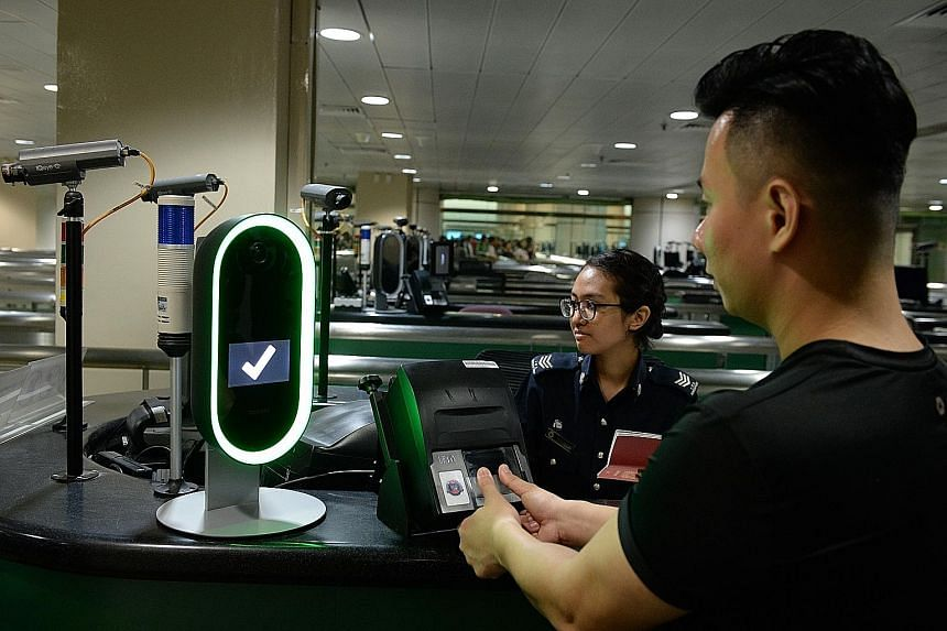 A demonstration of a biometric screening system with three modes of identification - fingerprint, facial and iris scans - at Woodlands Checkpoint. LIANHE ZAOBAO FILE PHOTO