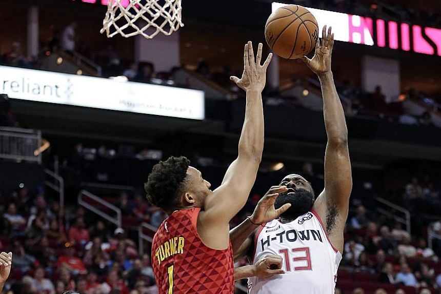 Houston's James Harden shooting over Atlanta guard Evan Turner on Saturday, when he came within one point of his career high.