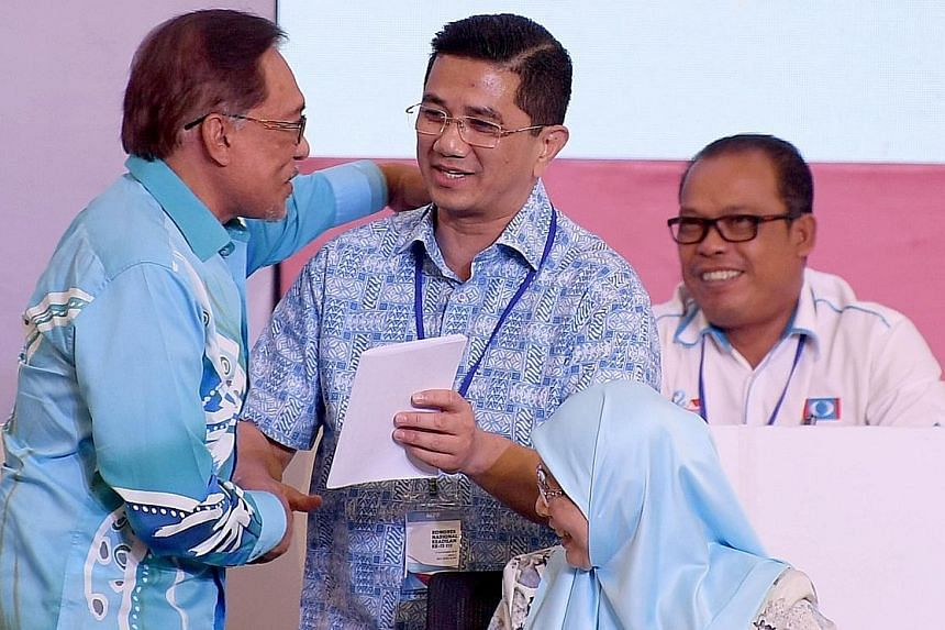 In this file photo taken last year, Parti Keadilan Rakyat chief Anwar Ibrahim (left) is seen congratulating PKR deputy president Azmin Ali after the latter gave a speech at the 13th PKR National Congress 2018.