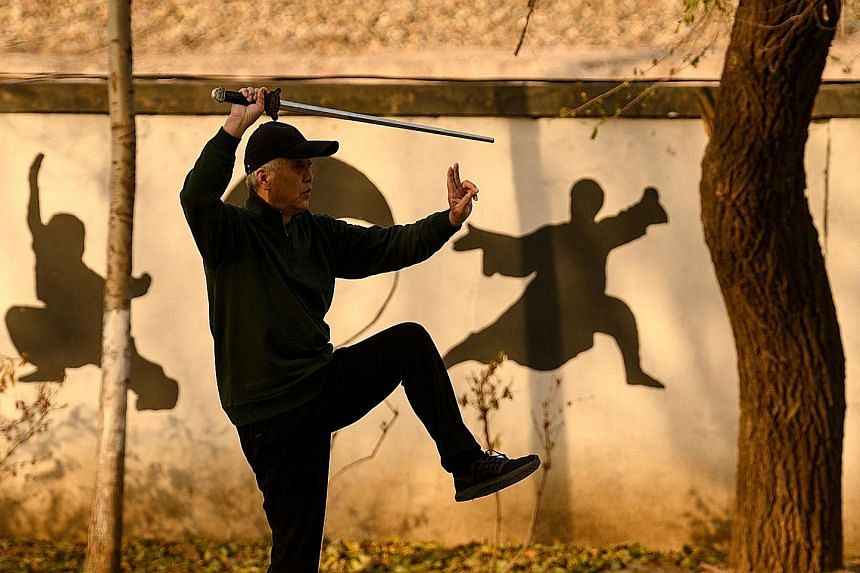An elderly man practising martial arts at a park in Beijing. China's ageing population is partly due to a doubling of life expectancy over the last 70 years and stubbornly low birth rates. The country's plan to tackle the issue calls for a basic inst