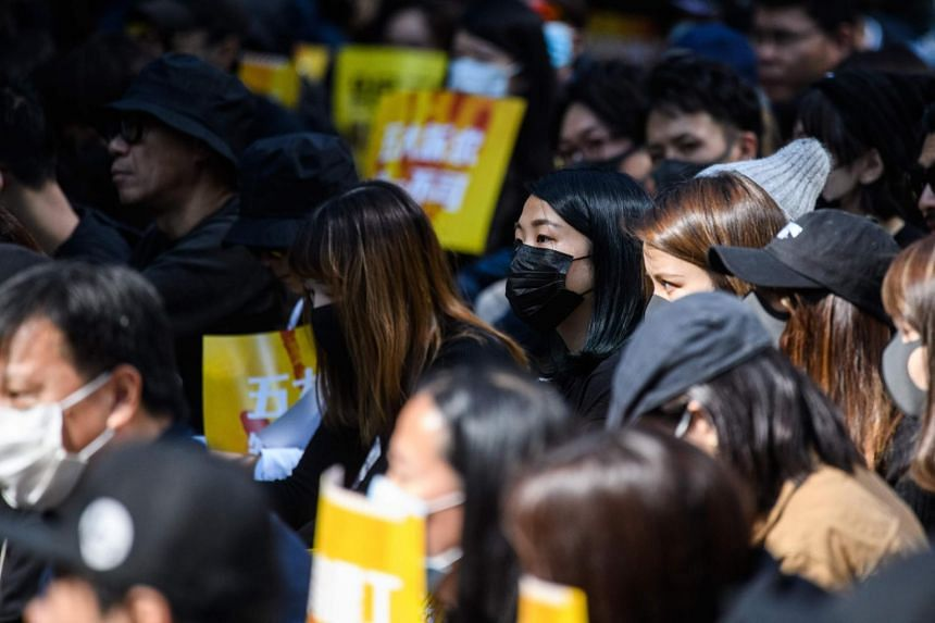Workers from the advertising sector attend a rally to commence a five day strike, at Chater Garden in Hong Kong, on Dec 2, 2019.