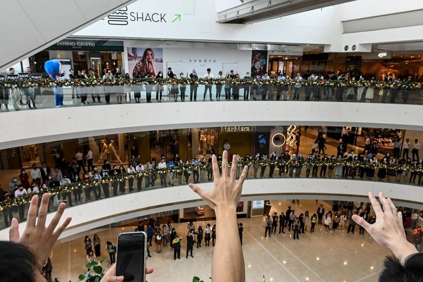 Office workers gather in support of pro-democracy protesters during a lunch break rally at a shopping mall in the Central district of Hong Kong, on Nov 26, 2019.