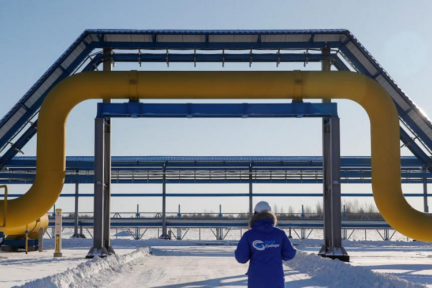 An employee walks past a part of Gazprom's Power Of Siberia gas pipeline at the Atamanskaya compressor station outside the far eastern town of Svobodny, in Amur region, Russia, on Nov 29, 2019.