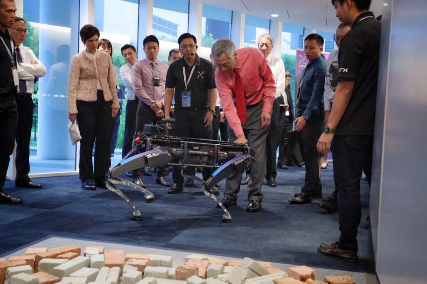 Prime Minister Lee Hsien Loong interacting with the Rover-X robotic dog at the launch of the Home Team Science and Technology Agency (HTX) on Dec 2, 2019.