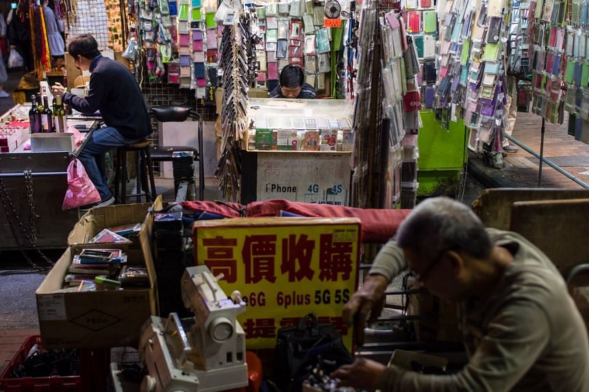 Street stall owners work at their booths in the Sham Shui Po district of Hong Kong, on Nov 30, 2019.