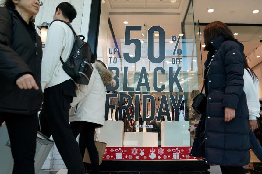 In a photo taken on Nov 29, 2019, people walk through the King of Prussia mall, one of the largest retail malls in the US, on Black Friday, in Pennsylvania.