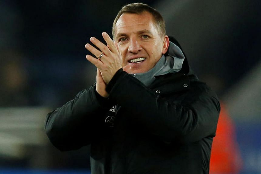 Leicester City manager Brendan Rodgers applauds fans after the match against Everton on Dec 1, 2019.