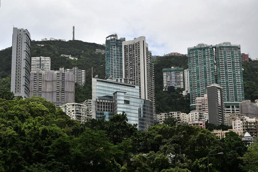 Properties at The Peak in Hong Kong, on July 5, 2019. Spinning off rental properties into Reits could narrow the discount to net asset value and enable family-owned entities to retain control while generating capital that could be redeployed into bet