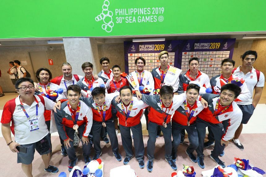 The Singapore men's water polo team with their team manager and coach after receiving their bronze medals at New Clark City Aquatic Centre on Dec 1, 2019.