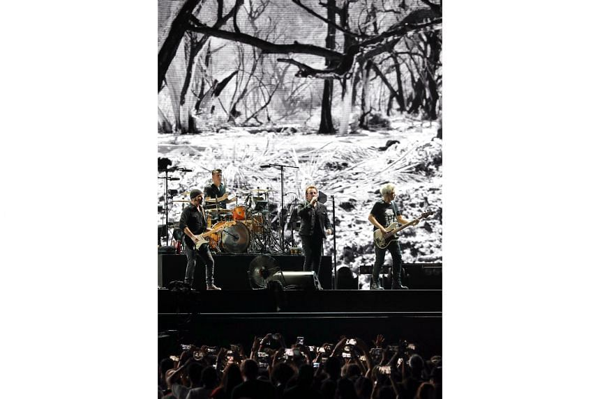 Cinematic visuals by Dutch photographer Anton Corbijn on the giant screen at U2's concert are evocative and enhance the magnitude of the songs.