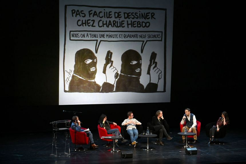 In a photo taken on Nov 2, 2019, the editorial team of Charlie Hebdo newspaper taking part in a discussion about the freedom of the press during a World Forum for Democracy.