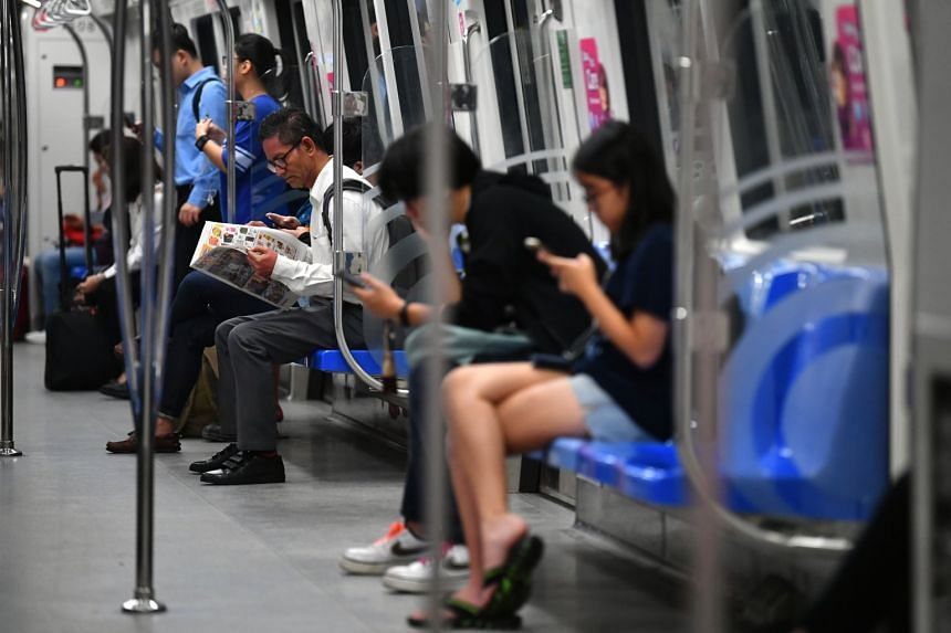 Passengers on an MRT train on Nov 5, 2019.