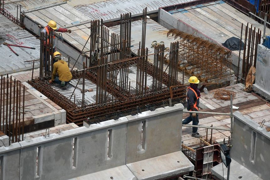 Workers in a construction site in Kim Keat Avenue, on Nov 5, 2019.