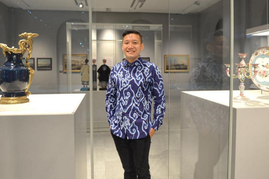 Asian Civilisations Museum director Kennie Ting stands next to two displays from China, a pair of mounted blue jars (left) and his favourite piece, the Candelabra and Dish (right).