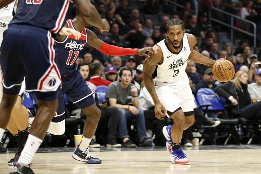 Kawhi Leonard of the Los Angeles Clippers drives around Isaac Bonga of the Washington Wizards during the second half at Staples Center, on Dec 1, 2019, in Los Angeles, California.